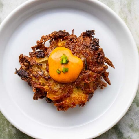 Kimchi Latke with Gochujang Sour Cream with Marble Background