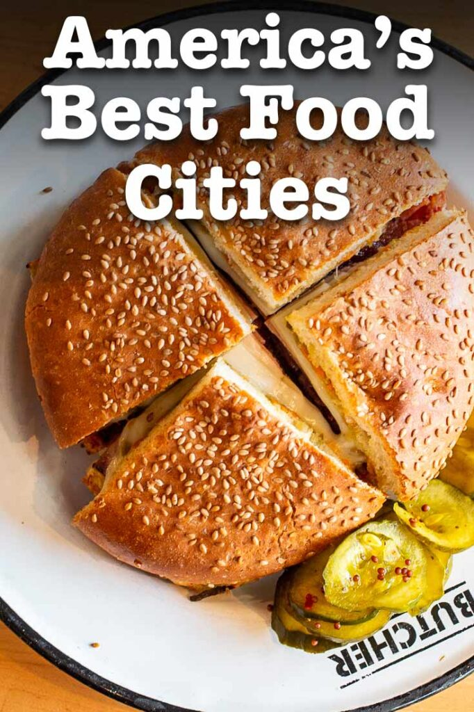 """Pinterest image: image of a Muffaletta with caption reading """"America's Best Food Cities"""""""
