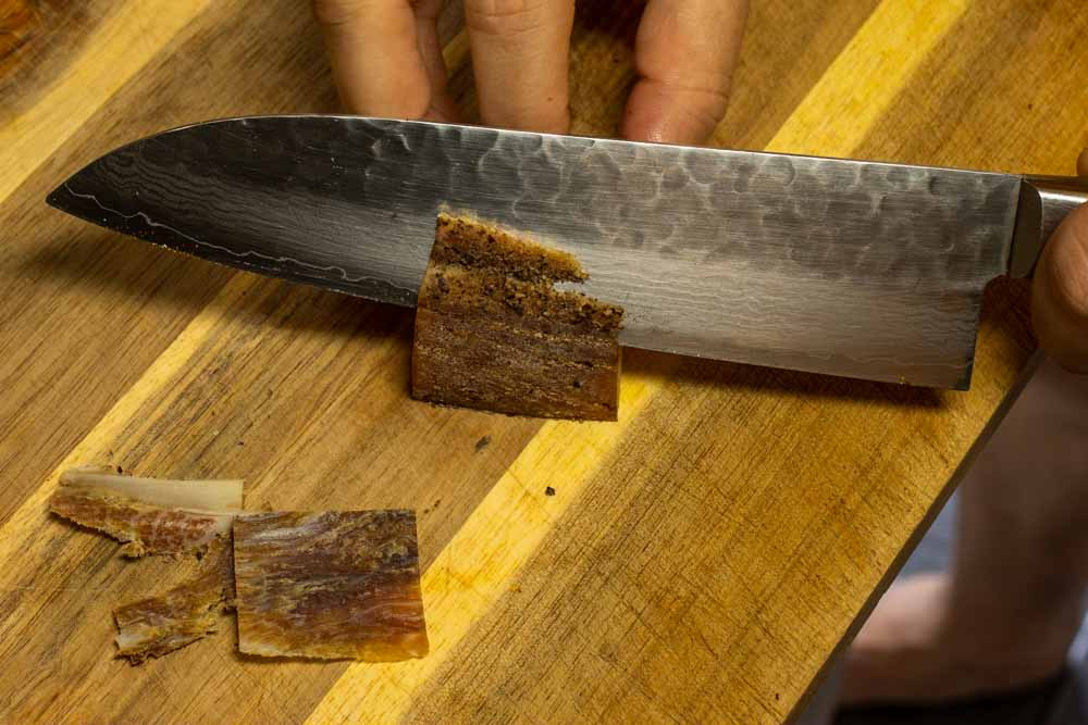 Cutting Pecorino Romano with Knife