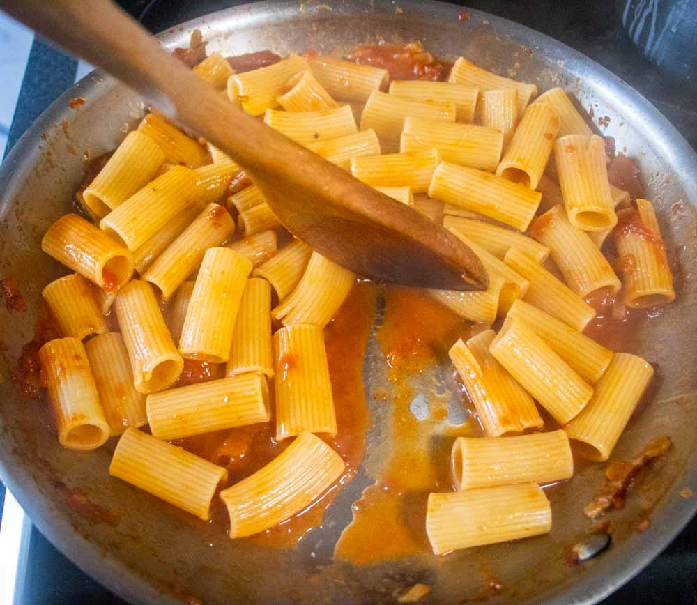 Rigatoni Amatriciana Mixing the Pasta and Sauce