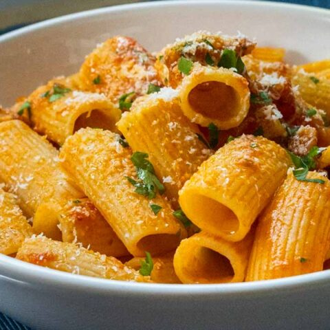 Rigatoni Amatriciana in White Bowl