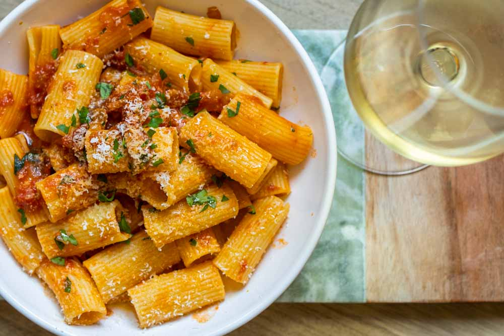 Rigatoni Amatriciana with White Wine on Green Marble
