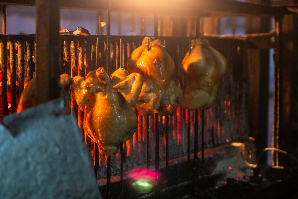 Roasting Chickens at SP Chicken in Chiang Mai
