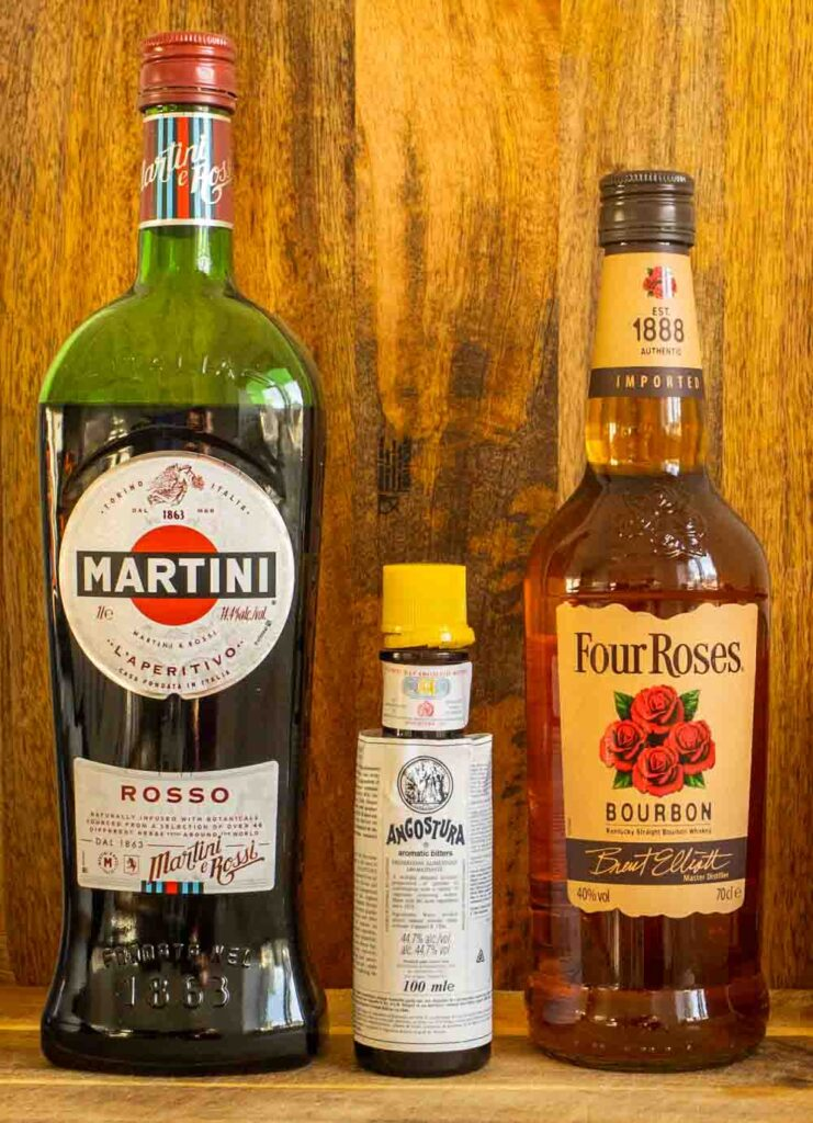 Bottles of Sweet Vermouth, Bitters and Bourbon