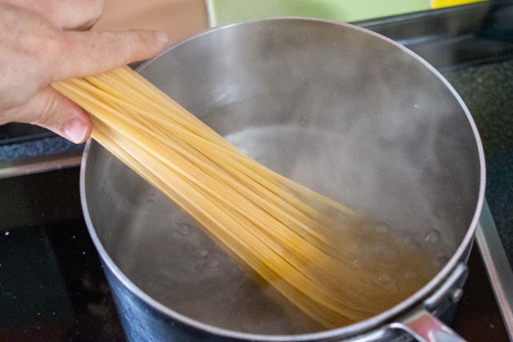 Dropping Pasta in Saucepan