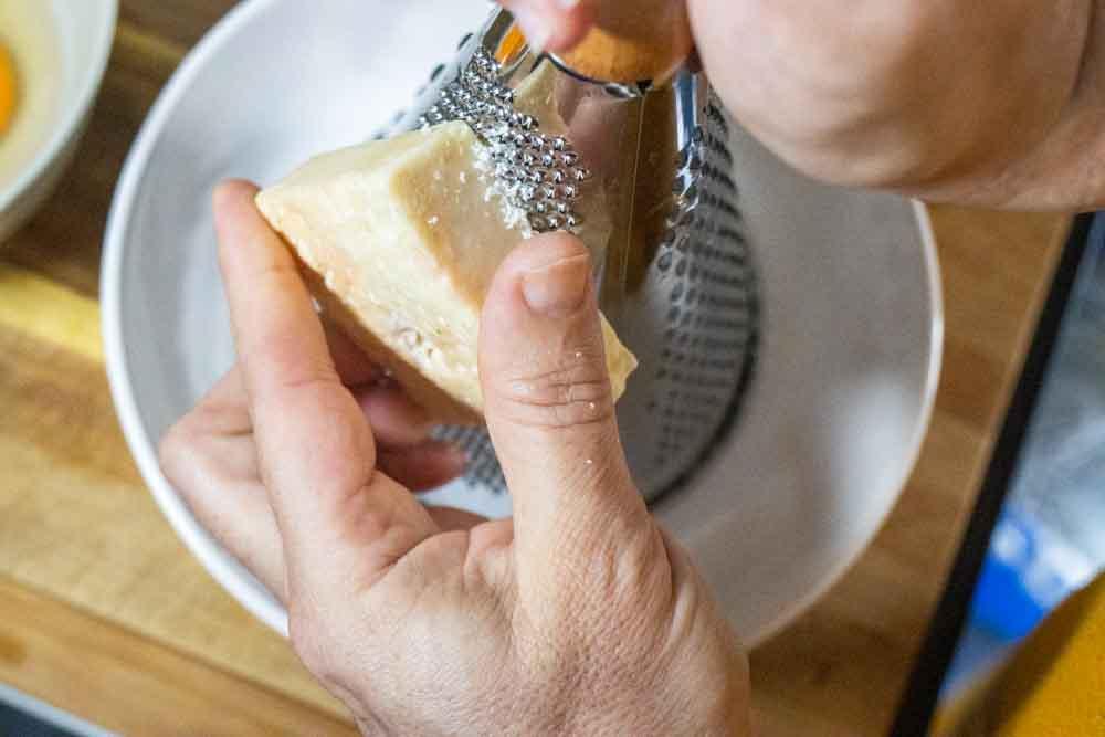 Grating Pecorino Romano Cheese