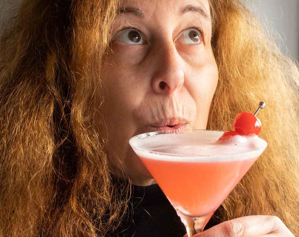 Mindi Drinks a Pink Lady Cocktail
