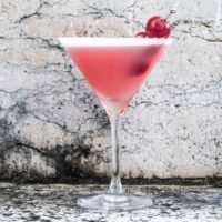 Pink Lady Cocktail with Cherries