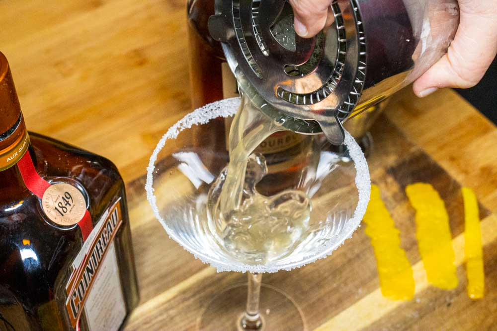 Straining Bourbon Sidecar into Glass