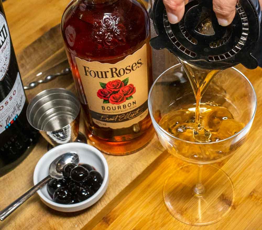 Straining Manhattan into Coupe Glass