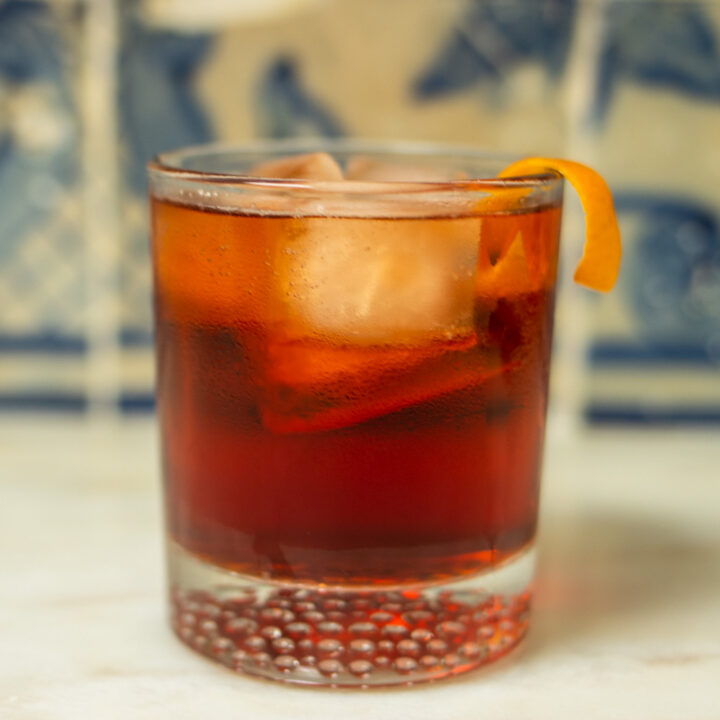 Americano Cocktail Next to Blue Tiles