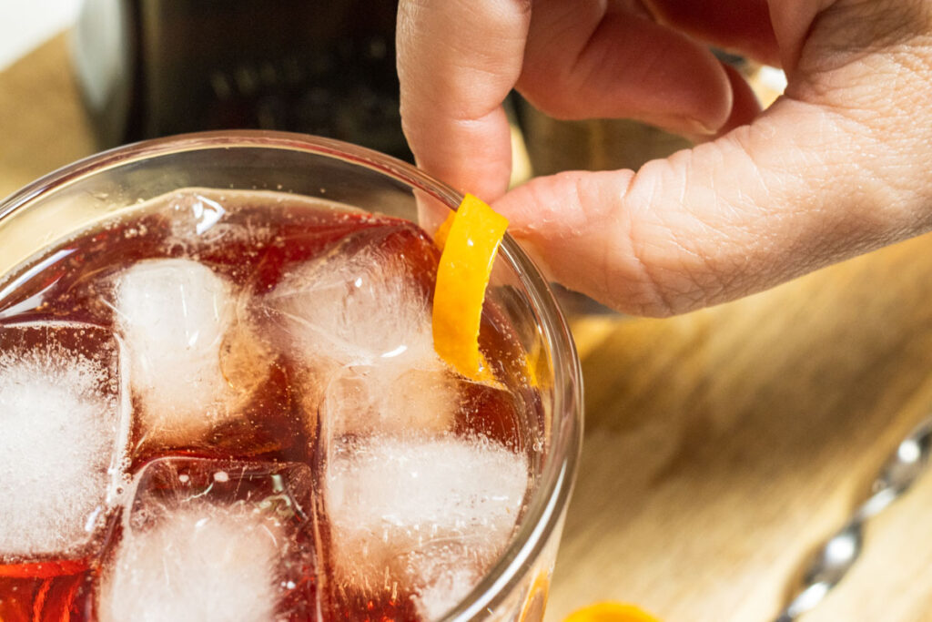 Expressing Americano Cocktail with Orange Peel