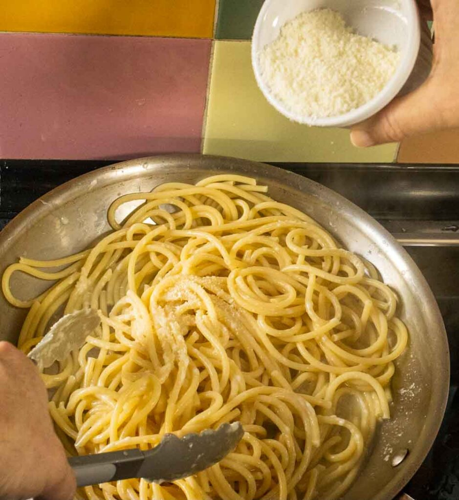 Pouring Cheese into Bucatini Cacio e Pepe