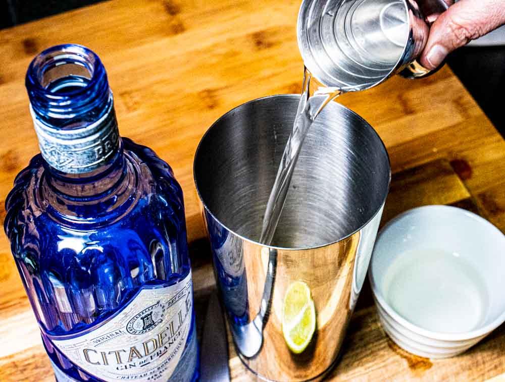 Pouring Gin into a Gin Gimlet