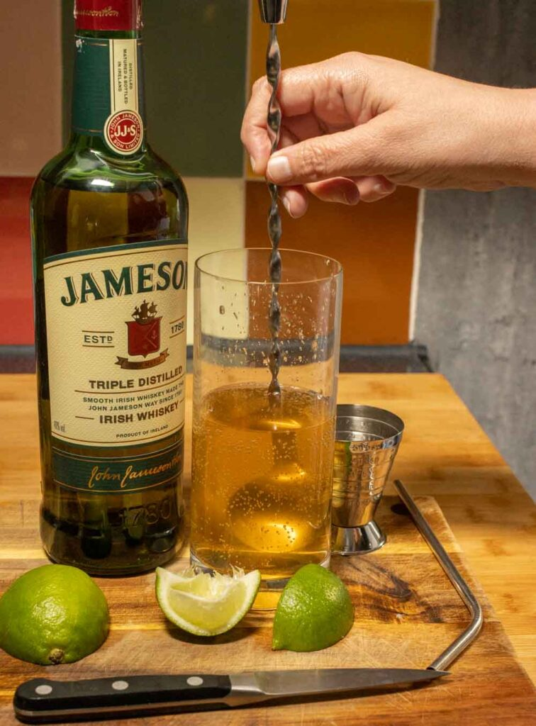 Stirring a Jameson Whiskey Ginger