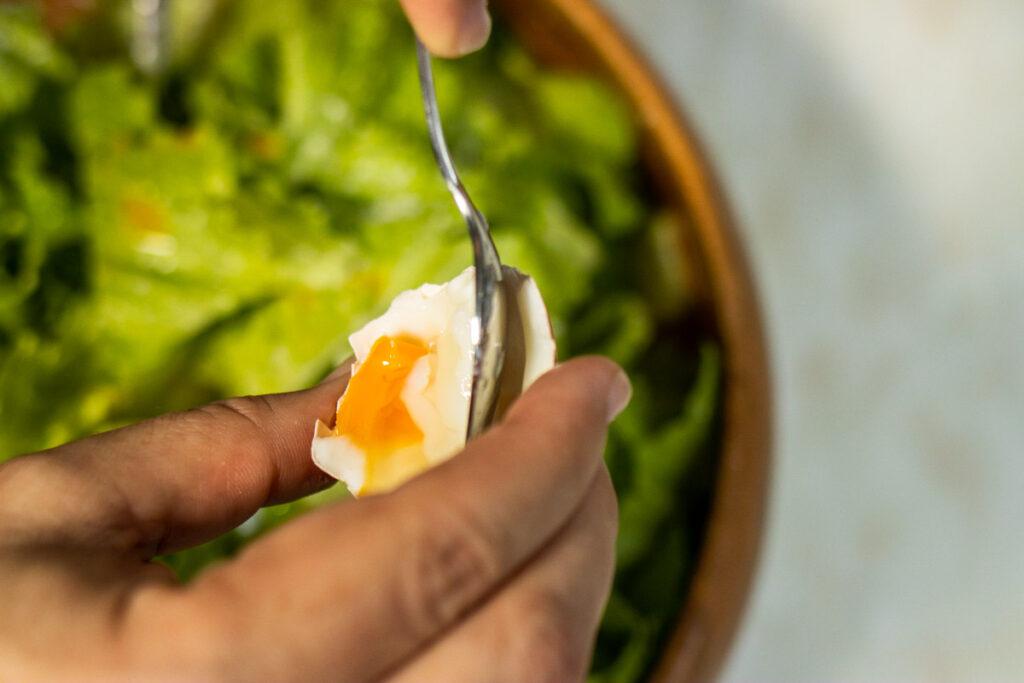 Adding Coddled Egg to Caesar Salad