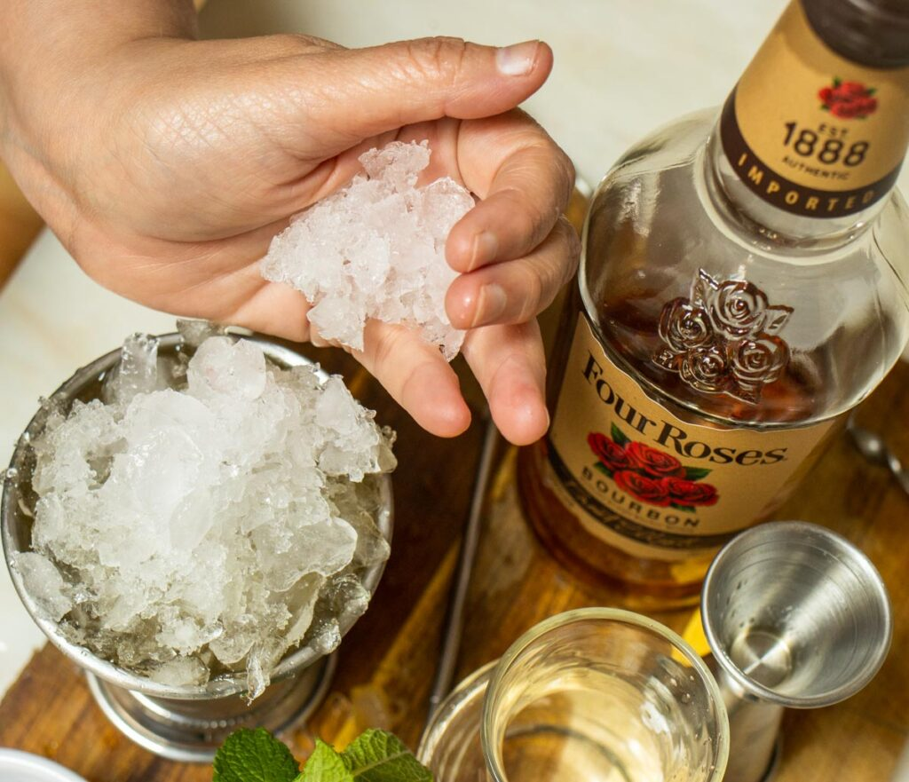 Adding Ice to a Mint Julep