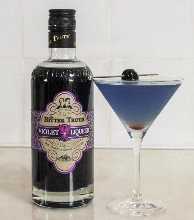 Aviation Cocktail Next to Creme de Violette Bottle