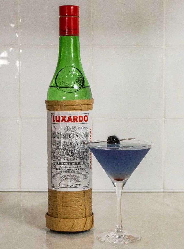 Aviation Cocktail Next to Luxardo Maraschino Liqueur