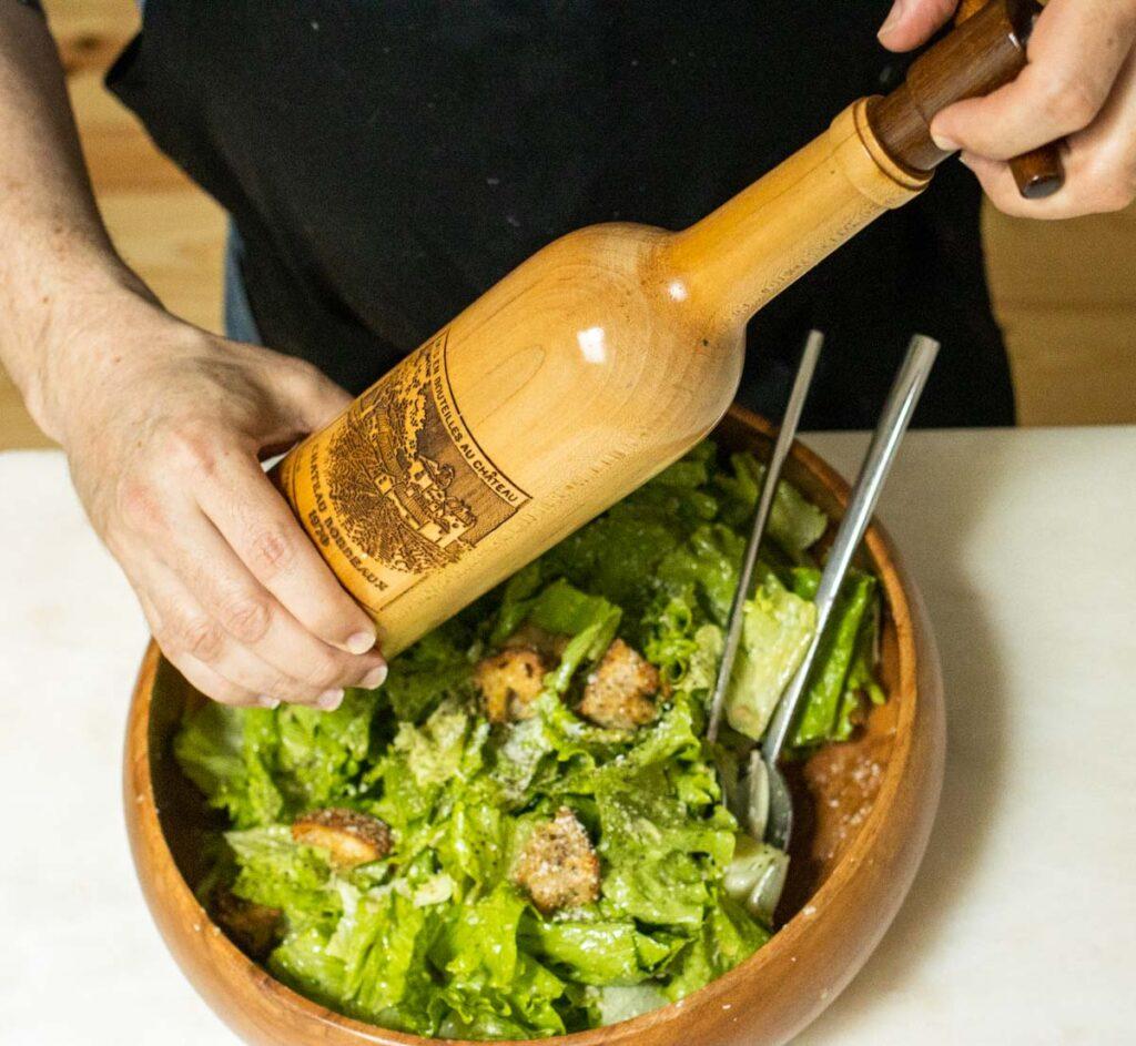 Adding Pepper to Caesar Salad