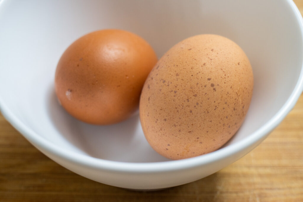 Two Eggs in White Bowl
