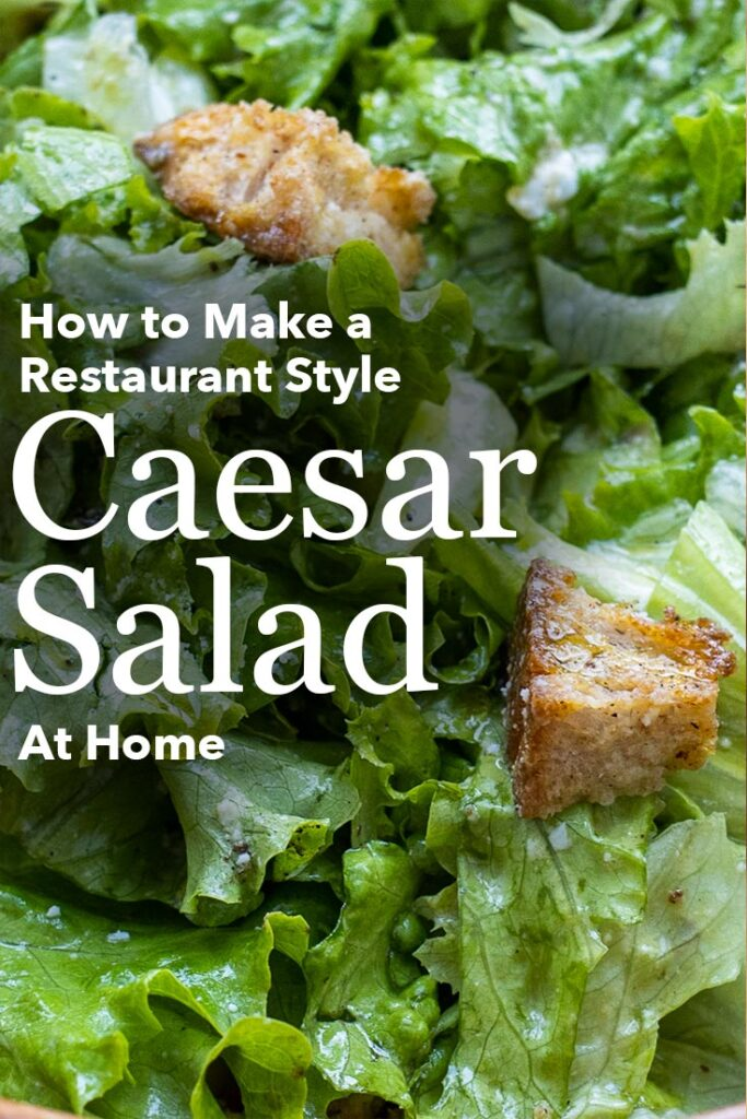 """Pinterest image: caesar salad with caption reading """"How to Make a Restaurant Style Caesar Salad at Home"""""""