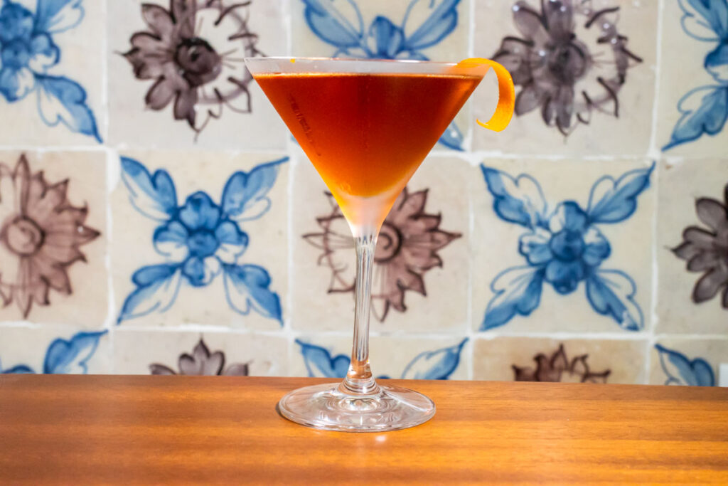 Martinez Cocktail Next to Colored Tiles