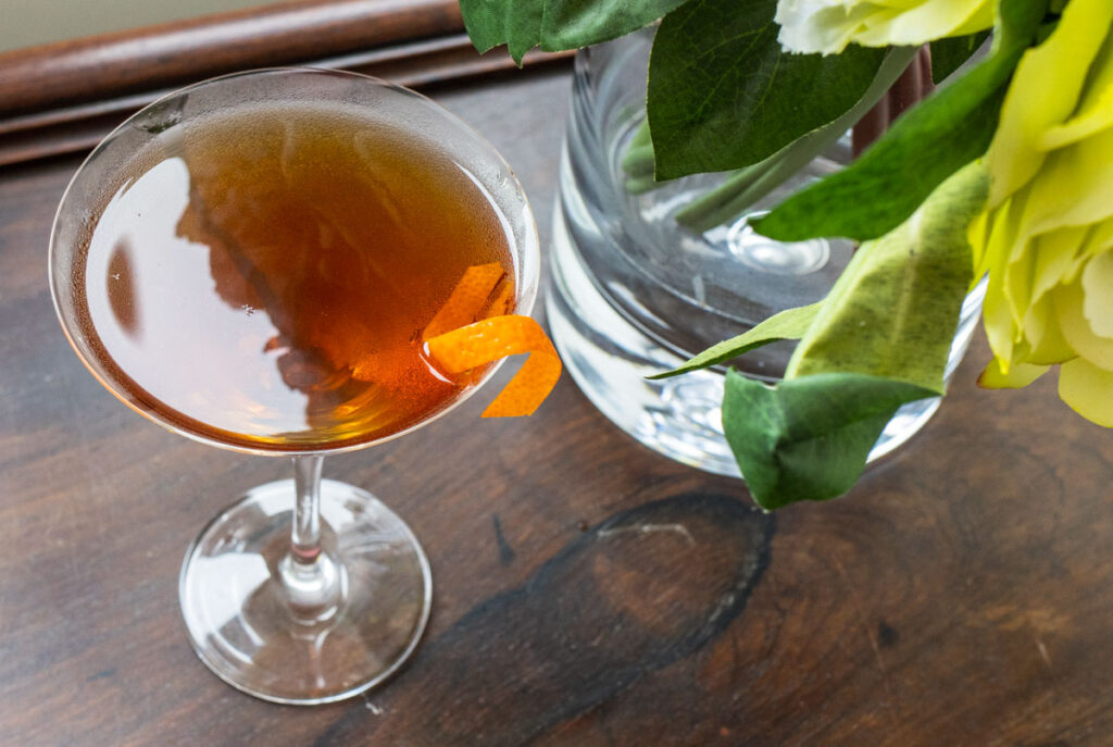 Martinez Cocktail Next to Flowers