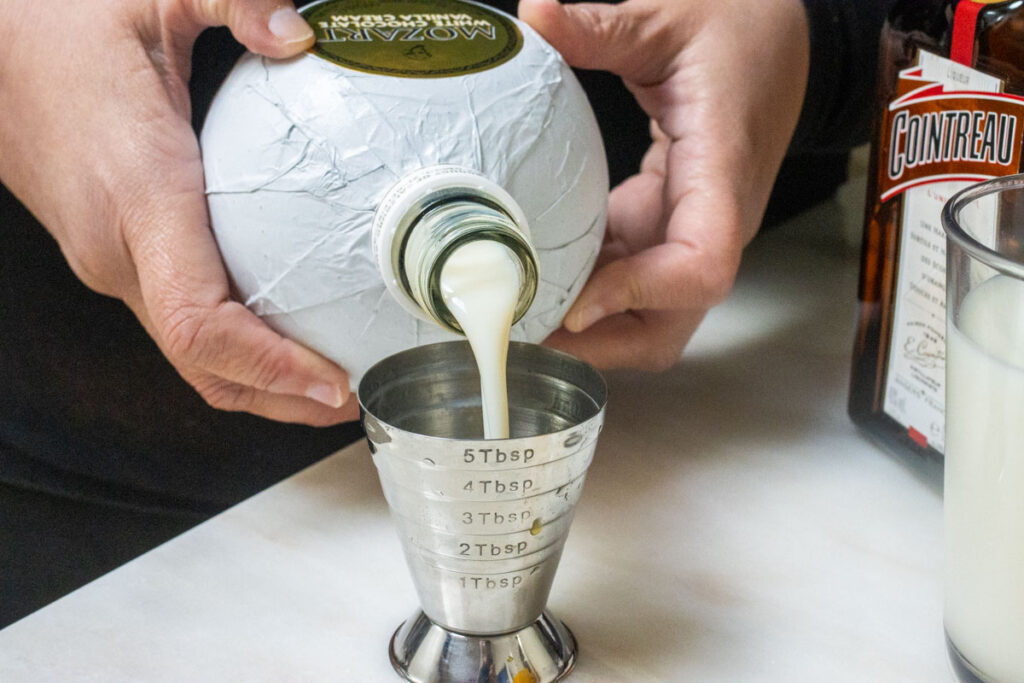 Measuring Mozart White Chocolate Liqueur with Jigger