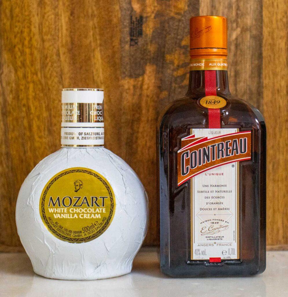 Mozart White Chocolate Liqueur and Cointreau bottles