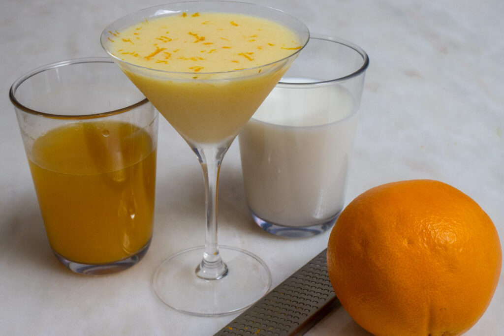 Orange Creamsicle Cocktail with Orang Juice, Milk and Orange