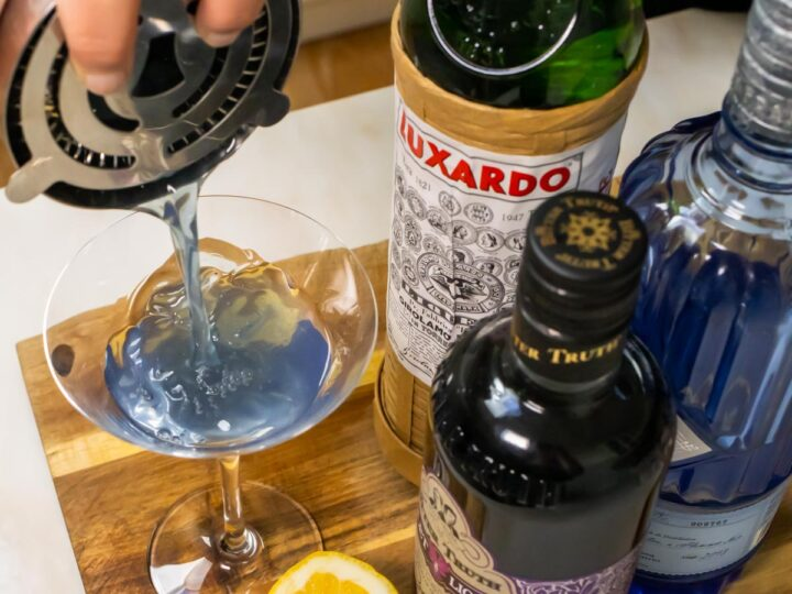Straining Aviation Cocktail into Glass