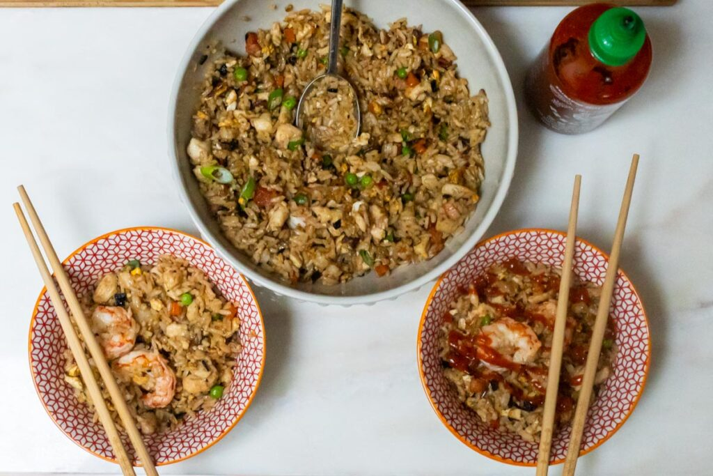 Yangzhou Fried Rice with Sriracha and Two Serving Bowls