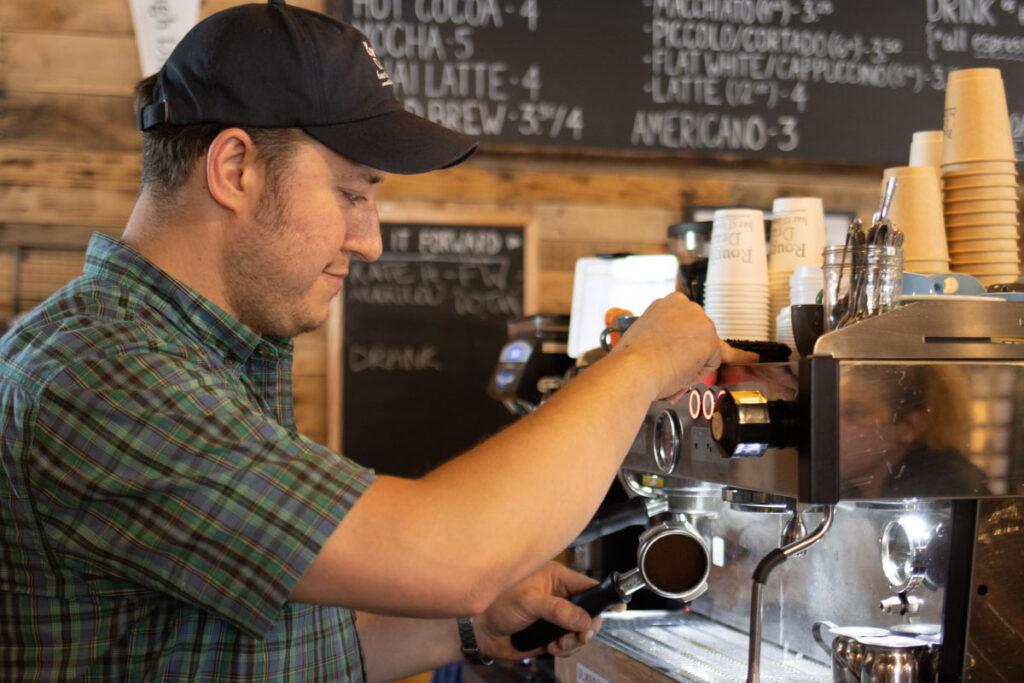 Barista at Rough Draft Bar and Books in Kingston