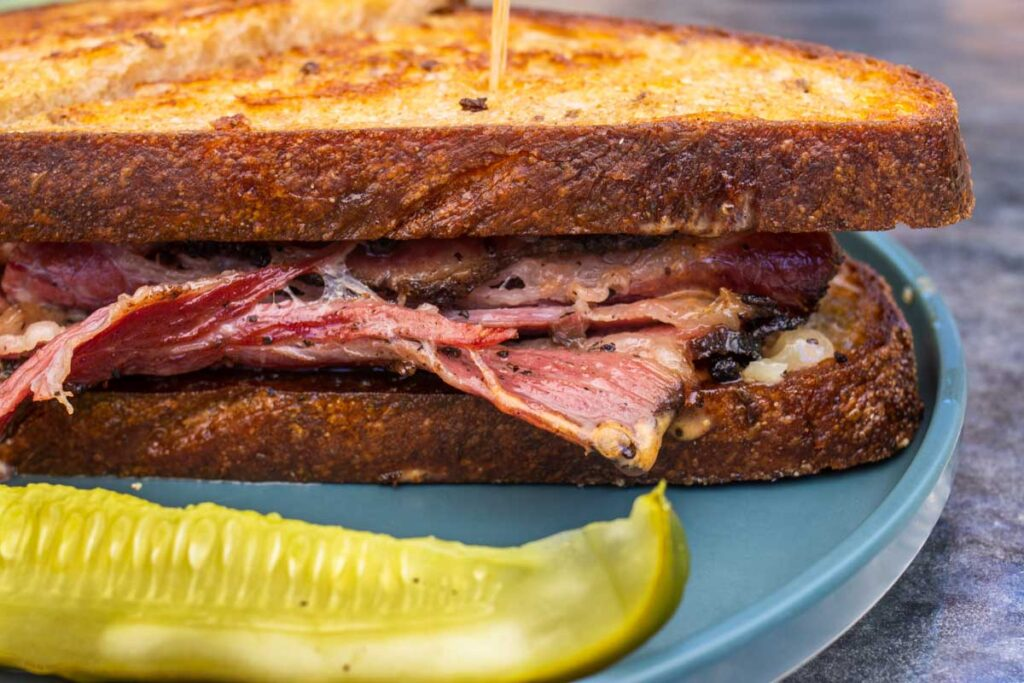 Reuben Sandwich and Pickle at Lunch Nightly in Kingston