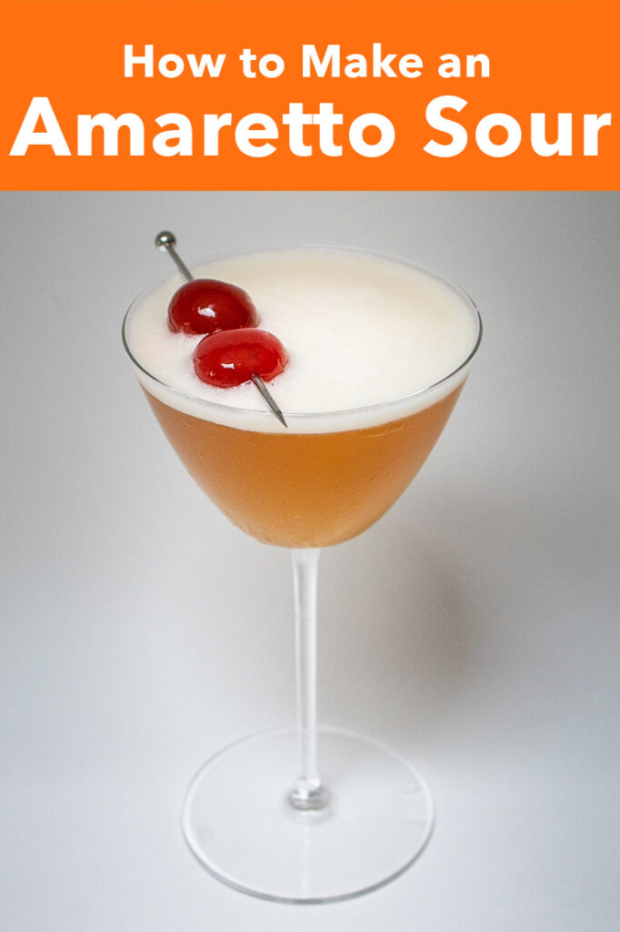 """Pinterest image: photo of amaretto sour with caption reading """"How to Make an Amaretto Sour"""""""