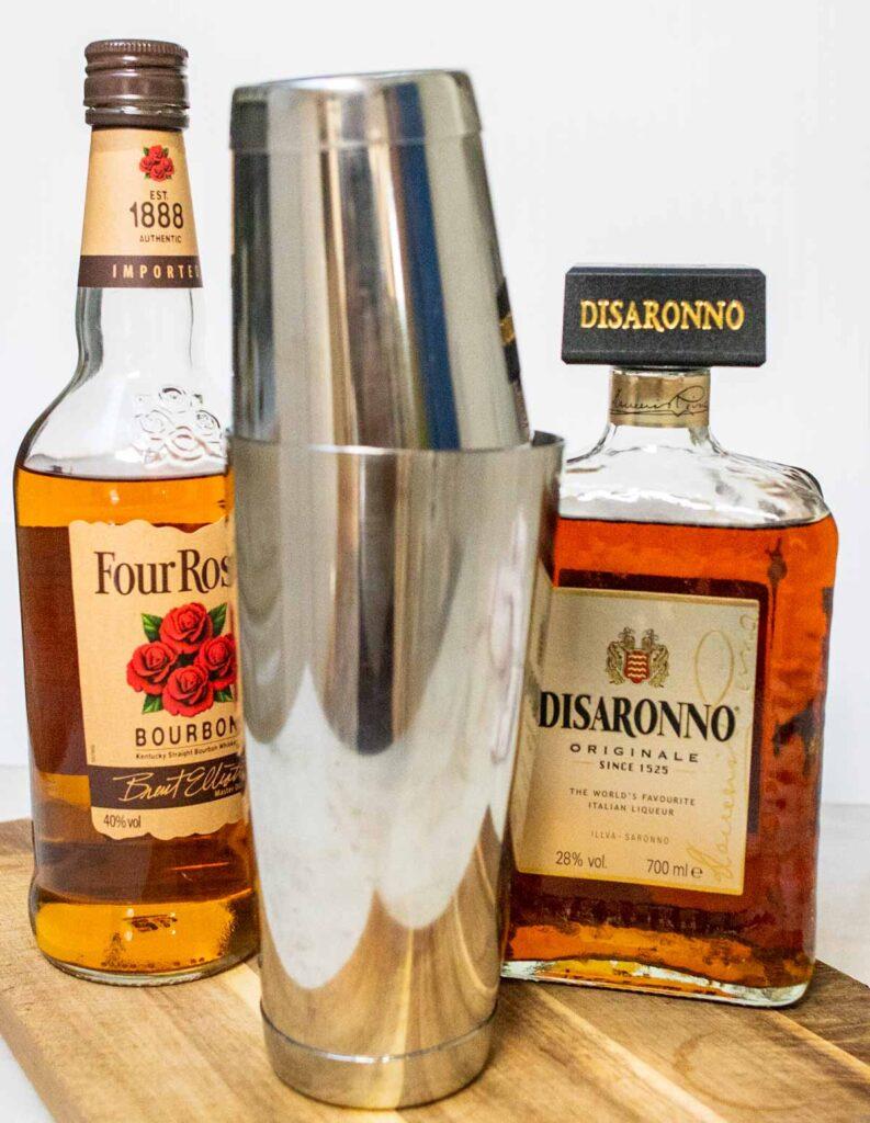 Amaretto Sour in Shaker Next to Liquor Bottles