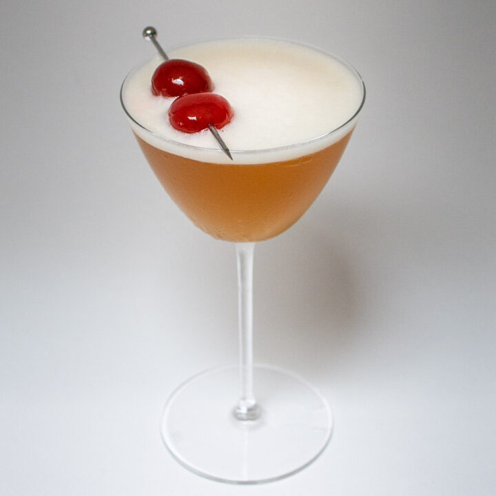 Amaretto Sour with Grey Background