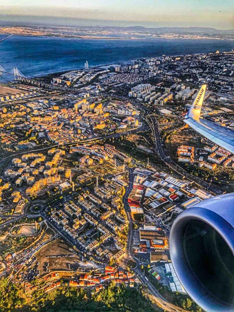 Plane over Lisbon Skyline