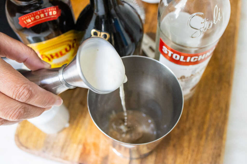 Pouring Cream into Mudslide Cocktail