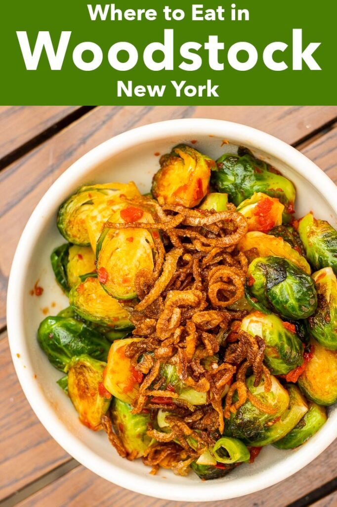"""Pinterest image: photo of brussels sprouts with caption reading """"Where to Eat in Woodstock New York"""""""
