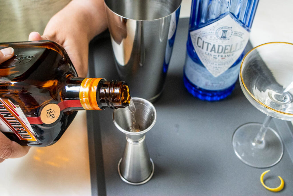 Measuring Cointreau for a White Lady Cocktail