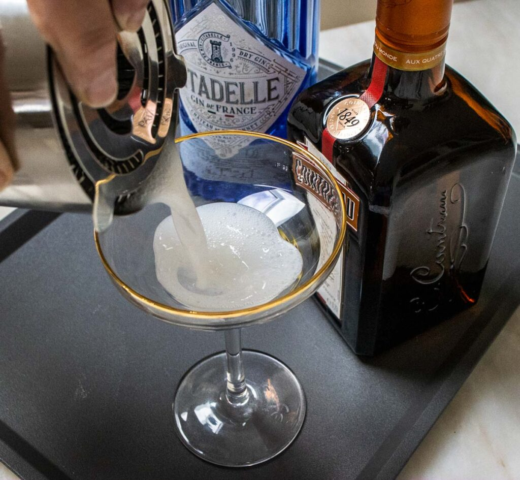 Straining a White Lady Cocktail